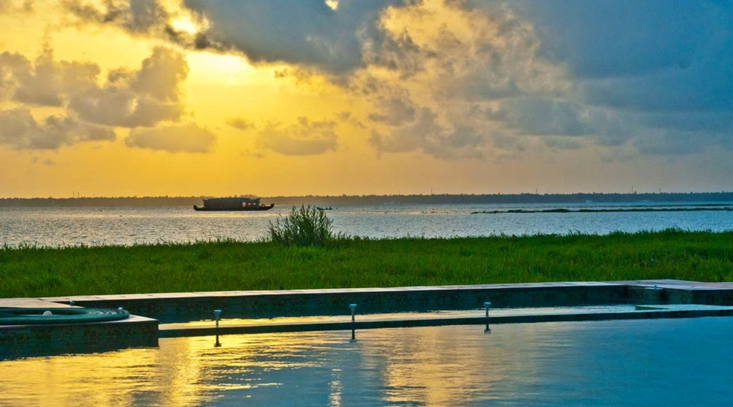 Sunset and boat at Waterscapes KTDC Backwater Resort