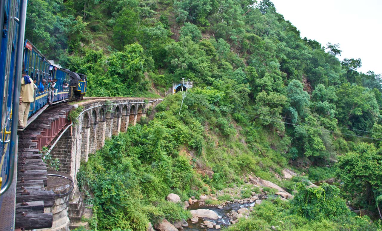 Nilgiri mountain railway train on bridge