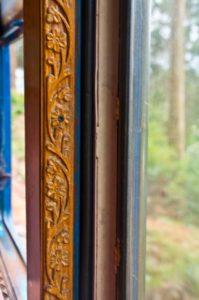 Wood carving on carriage of Nilgiri mountain railway
