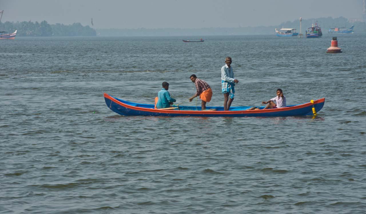Fisherman in sea