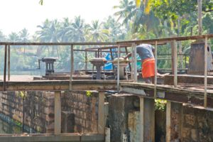 Man operating Water gates in Kerala Backwaters
