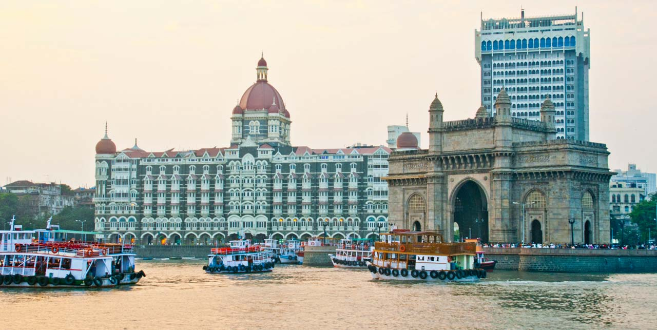 Gateway of India and Taj Mahal hotel from boat in sea