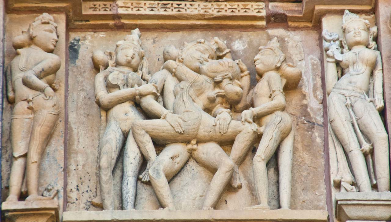 Erotic sculptures on temple walls of Khajuraho