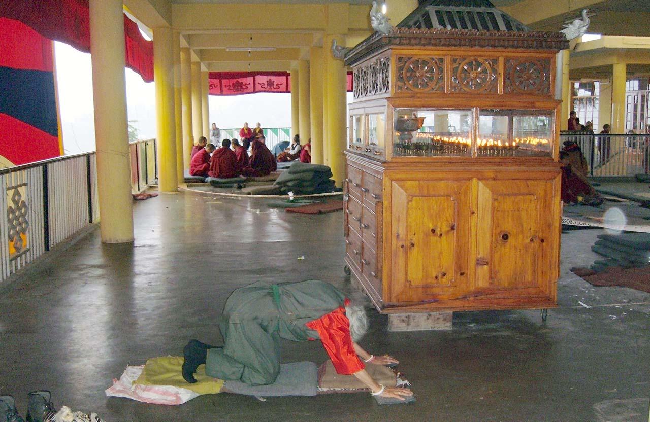 Worshipper in Dalai Lama temple Mcleodganj