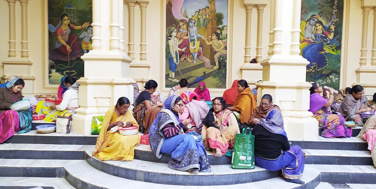 Women making garlands